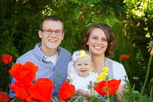 Small family in poppy fields