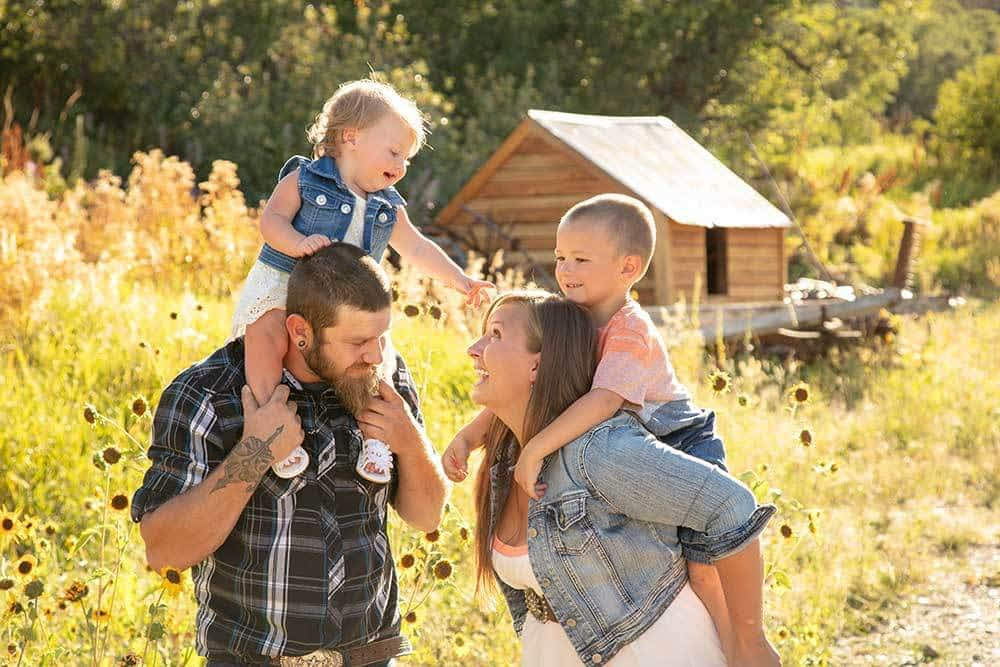 candid family portrait at a barn
