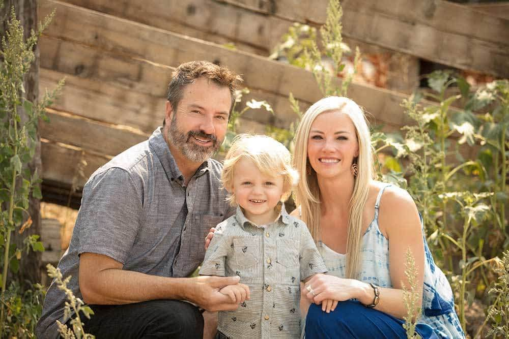 family portrait at a barn