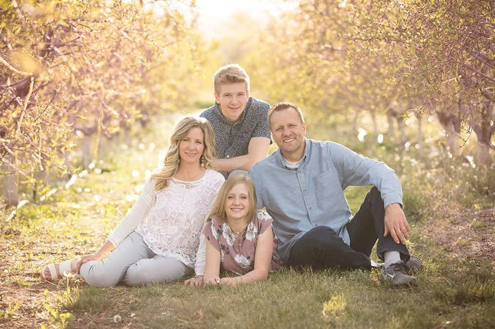 family in peach orchard